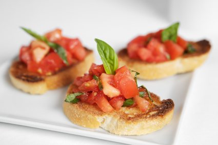 Italian Bruschetta appetizer on a white porcelain plate.